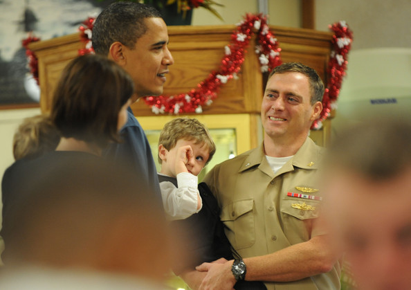 (AFP OUT) U.S. President Barack Obama greet soldiers and their family members for Christmas during a visit to Marine Corps Base Hawaii on December 25, 2009 in Kaneohe Bay, Hawaii. Obama and his family will spend Christmas and New Year in Hawaii.