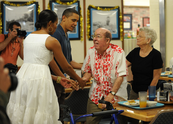 (AFP OUT) U.S. President Barack Obama and First Lady Michelle Obama greet soldiers and their family members for Christmas during a visit to Marine Corps Base Hawaii on December 25, 2009 in Kaneohe Bay, Hawaii. Obama and his family will spend Christmas and New Year in Hawaii.