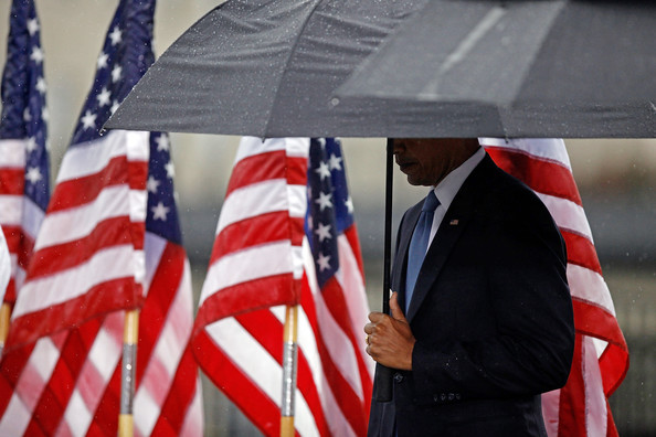 In driving rain, U.S. President Barack Obama bows his head during a moment of silence during a 9/11 Rememberance Ceremony at the Pentagon September 11, 2009 in Arlington, Virginia. Obama joined staff and family members at the Pentagon to comemorate the eighth anniversary of the September 11 attacks.
