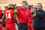 Head coach Randy Edsall (C) of the Maryland Terrapins greets his defense after they made a goal-line stand during the second half of their 52-24 loss to the Ohio State Buckeyes at Byrd Stadium on October 4, 2014 in College Park, Maryland.
