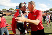 Head coach Urban Meyer (L) of the Ohio State Buckeyes shakes hands at midfield with head coach Randy Edsall of the Maryland Terrapins (R) after Ohio State's 52-24 win at Byrd Stadium on October 4, 2014 in College Park, Maryland.