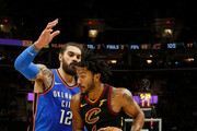 Derrick Rose #1 of the Cleveland Cavaliers drives the ball past Steven Adams #12 of the Oklahoma City Thunder during the fourth quarter at Quicken Loans Arena on January 20, 2018 in Cleveland, Ohio. Oklahoma City defeated Cleveland 148-124. NOTE TO USER: User expressly acknowledges and agrees that, by downloading and or using this photograph, User is consenting to the terms and conditions of the Getty Images License Agreement.
