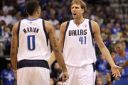 Dirk Nowitzki #41 of the Dallas Mavericks reacts as he looks over at teammate Shawn Marion #0 in the third quarter against the Oklahoma City Thunder in Game Two of the Western Conference Finals during the 2011 NBA Playoffs at American Airlines Center on May 19, 2011 in Dallas, Texas. NOTE TO USER: User expressly acknowledges and agrees that, by downloading and or using this photograph, User is consenting to the terms and conditions of the Getty Images License Agreement.
