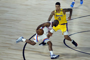 Chris Paul #3 of the Oklahoma City Thunder is fouled by Kyle Kuzma #0 of the Los Angeles Lakers during the second quarter at HP Field House at ESPN Wide World Of Sports Complex on August 05, 2020 in Lake Buena Vista, Florida. NOTE TO USER: User expressly acknowledges and agrees that, by downloading and or using this photograph, User is consenting to the terms and conditions of the Getty Images License Agreement.