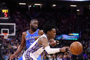 De'Aaron Fox #5 of the Sacramento Kings dribbles past Raymond Felton #2 of the Oklahoma City Thunder at Golden 1 Center on November 7, 2017 in Sacramento, California. NOTE TO USER: User expressly acknowledges and agrees that, by downloading and or using this photograph, User is consenting to the terms and conditions of the Getty Images License Agreement.