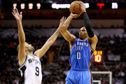 Russell Westbrook #0 of the Oklahoma City Thunder goes for a shot against Tony Parker #9 of the San Antonio Spurs in the third quarter in Game One of the Western Conference Finals during the 2014 NBA Playoffs at AT&T Center on May 19, 2014 in San Antonio, Texas. NOTE TO USER: User expressly acknowledges and agrees that, by downloading and or using this photograph, User is consenting to the terms and conditions of the Getty Images License Agreement.