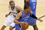 Russell Westbrook #0 of the Oklahoma City Thunder drives on Tony Parker #9 of the San Antonio Spurs in the first half in Game One of the Western Conference Finals during the 2014 NBA Playoffs at AT&T Center on May 19, 2014 in San Antonio, Texas. NOTE TO USER: User expressly acknowledges and agrees that, by downloading and or using this photograph, User is consenting to the terms and conditions of the Getty Images License Agreement.