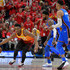 Russell Westbrook Photos - Donovan Mitchell #45 of the Utah Jazz dribbles around Paul George #13 and Russell Westbrook #0 of the Oklahoma City Thunder in the second half during Game Three of Round One of the 2018 NBA Playoffs at Vivint Smart Home Arena on April 21, 2018 in Salt Lake City, Utah. The Jazz beat the Thunder 115-102. NOTE TO USER: User expressly acknowledges and agrees that, by downloading and or using this photograph, User is consenting to the terms and conditions of the Getty Images License Agreement. - Oklahoma City Thunder vs. Utah Jazz - Game Three