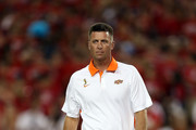Head coach Mike Gundy of the Oklahoma State Cowboys walks the field as his team warms up before the college football game against the Arizona Wildcats at Arizona Stadium on September 8, 2012 in Tucson, Arizona.