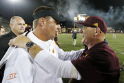 Head coach Mike Gundy of the Oklahoma State Cowboys meets with head coach John Bonamego of the Central Michigan Chippewas after the game at Kelly/Shorts Stadium on September 3, 2015 in Mount Pleasant, Michigan. Oklahoma State defeated Central Michigan 24-13.