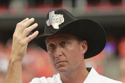 Head coach Mike Gundy of the Oklahoma State Cowboys accepts the trophy and cowboy hat as they defeated the Mississippi State Bulldogs in the Advocare Texas Kickoff at Reliant Stadium on August 31, 2013 in Houston, Texas.