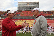 AMES, IA- NOVEMBER 3:  Head coach Paul Rhoads of the Iowa State Cyclones (R) listens to head coach Bob Stoops of the Oklahoma Sooners before their match-up on November 3, 2012 at Jack Trice Stadium in Ames, Iowa.