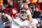 Tight end Blake Bell #10 of the Oklahoma Sooners celebrates with quarterback Trevor Knight #9 of the Oklahoma Sooners after scoring a touchdown in the second half of play against the Iowa State Cyclones at Jack Trice Stadium on November 1, 2014 in Ames, Iowa. The Oklahoma Sooners defeated the Iowa State Cyclones 59-14.