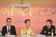 """(L-R) Nicolas Winding Refn, Miles Teller and Matthew Newman attend the """"Too Old To Die Young"""" press conference during the 72nd annual Cannes Film Festival on May 18, 2019 in Cannes, France."""