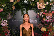 (L-R) Arielle Kebbel, wearing Olivia von Halle, attends the Olivia von Halle x Disney Maleficent: Mistress of Evil event at The High Line Hotel on October 16, 2019 in New York City.