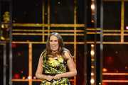 Host Catherine Tate speaks on stage during The Olivier Awards with Mastercard at Royal Albert Hall on April 8, 2018 in London, England.