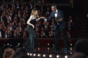 Cuba Gooding Jr. (R) presents Shirley Henderson (L) with the award for Best Actress In A Musical for 'Girl From The North Country' on stage during The Olivier Awards with Mastercard at Royal Albert Hall on April 8, 2018 in London, England.