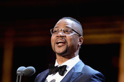 Cuba Gooding Jr. presents the award for Best Actress In A Musical on stage during The Olivier Awards with Mastercard at Royal Albert Hall on April 8, 2018 in London, England.