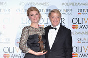 Jessica Swale (L) winner of the award for Best New Comedy for ' Nell Gwynn' and Presenter Eddie Izzard pose in the winners room at The Olivier Awards at The Royal Opera House on April 3, 2016 in London, England.