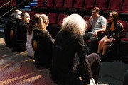 """Olympian Ryan Lochte (L) and dancer Cheryl Burke meet with creatives and performers during a rehearsal for their """"Dancing with the Stars"""" performance with the cast of """"O by Cirque du Soleil"""" at the Bellagio on September 30, 2016 in Las Vegas, Nevada."""