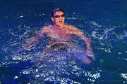 """Olympian Ryan Lochte swims in the pool at the """"O"""" theater as he and dancer Cheryl Burke rehearse for their """"Dancing with the Stars"""" performance with the cast of """"O by Cirque du Soleil"""" at the Bellagio on September 30, 2016 in Las Vegas, Nevada."""