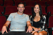 """Olympian Ryan Lochte (L) and dancer Cheryl Burke pose after watching a private performance of """"O by Cirque du Soleil"""" during a rehearsal for their """"Dancing with the Stars"""" performance with the cast of """"O"""" at the Bellagio on September 30, 2016 in Las Vegas, Nevada."""