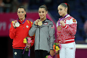 (R-L) Silver medalist Catalina Ponor of Romania, gold medalist Alexandra Raisman of the United States of America and bronze medalist Aliya Mustafina of Russia pose on the podium during the medal ceremony for the Artistic Gymnastics Women's Floor Exercise final on.Day 11 of the London 2012 Olympic Games at North Greenwich Arena on August 7, 2012 in London, England.