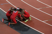 Keston Bledman, Marc Burns, Emmanuel Callender and Richard Thompson of Trinidad and Tobago form a huddle as they celebrate winning bronze after the Men's 4 x 100m Relay Final on Day 15 of the London 2012 Olympic Games at Olympic Stadium on August 11, 2012 in London, England.