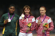 Silver medalist Caster Semenya of South Africa, gold medalist Mariya Savinova of Russia and bronze medalist Ekaterina Poistogova of Russia pose on the podium during the medal ceremony for the Women's 800m on Day 15 of the London 2012 Olympic Games at Olympic Stadium on August 11, 2012 in London, England.
