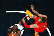 Kobe Bryant #10 of the United States dunks over Pau Gasol #4 of Spain during the Men's Basketball gold medal game between the United States and Spain on Day 16 of the London 2012 Olympics Games at North Greenwich Arena on August 12, 2012 in London, England.