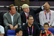 Arnold Schwarzenegger (L) and London Mayor Boris Johnson (C) during the Men's Basketball gold medal game between the United States and Spain on Day 16 of the London 2012 Olympics Games at North Greenwich Arena on August 12, 2012 in London, England.