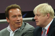 Arnold Schwarzenegger (L) and London Mayor Boris Johnson talk during the Men's Basketball gold medal game between the United States and Spain on Day 16 of the London 2012 Olympics Games at North Greenwich Arena on August 12, 2012 in London, England.
