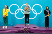(L-R) Silver medalist Emily Seebohm of Australia, gold medalist Missy Franklin of the UNited States and bronze medalist Aya Terakawa of Japan celebrate on the podium with their medals during the medal ceremony for the Women's 100m Backstroke on Day 3 of the London 2012 Olympic Games at the Aquatics Centre on July 30, 2012 in London, England.