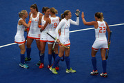 Ellen Hoog (3L) of the Netherlands is congratulated by team-mates after scoring their second goal during the Women's Hockey Match between the Netherlands and Japan on day 4 of the London 2012 Olympic Games at Hockey Centre on July 31, 2012 in London, England.