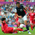 Abby Wambach Kim Myong Gum Photos - Abby Wambach of United States is tackled by Kim Myong Gum of DPR Korea during the Women's Football first round Group G match between the United States and DPR Korea,on Day 4 of the London 2012 Olympic Games at Old Trafford on July 31, 2012 in Manchester, England. - Olympics Day 4 - Women's Football - USA v DPR Korea