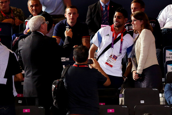 Princess Beatrice of York (R) and Amir Khan pose for photogrpahs on Day 5 of the London 2012 Olympic Games at ExCeL on August 1, 2012 in London, England.