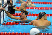 (L-R) Ryan Lochte and Michael Phelps of the United States look on after they competed in the first semifinal heat of the Men's 200m Individual Medleyon Day 5 of the London 2012 Olympic Games at the Aquatics Centre on August 1, 2012 in London, England.