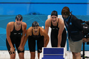 (L-R) Shannon Vreeland, Dana Vollmer and Missy Franklin of the United States watch teammate Allison Schmitt finish first to win the Final of the Women's 4x200m Freestyle Relay on Day 5 of the London 2012 Olympic Games at the Aquatics Centre on August 1, 2012 in London, England.