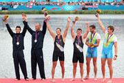 Silver medalists Romano Battisti and Alessio Sartori of Italy, gold medalists Nathan Cohen and Joseph Sullivan of New Zealand and bronze meadlists Luka Spik and Iztok Cop of Slovenia celebrate with their medals during the medal ceremony for the Men's Double Sculls final on Day 6 of the London 2012 Olympic Games at Eton Dorney on August 2, 2012 in Windsor, England.