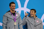 Gold medallist Michael Phelps of the United States reacts whilst waiting the receive hsi medal alongside Silver medallist Ryan Lochte of the United States on the podium during the medal ceremony for the Men's 200m Individual Medley final on Day 6 of the London 2012 Olympic Games at the Aquatics Centre on August 2, 2012 in London, England.