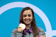 Gold medallist Rebecca Soni of the United States poses on the podium during the medal ceremony for the Women's 200m Breaststroke Final on Day 6 of the London 2012 Olympic Games at the Aquatics Centre on August 2, 2012 in London, England. Soni set a new world record time of 2:19.59 for the event.