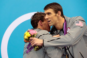 Gold medallist Michael Phelps (R) of the United States hugs Silver medallist Ryan Lochte of the United States on the podium during the medal ceremony for the Men's 200m Individual Medley final on Day 6 of the London 2012 Olympic Games at the Aquatics Centre on August 2, 2012 in London, England.