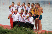 Gold medalists Tim Grohmann, Lauritz Schoof, Phillipp Wende and Karl Schulze of Germany (front), silver medalists Valent Sinkovic, Damir Martin, Martin Sinkovic and David Sain of Croatia (left) and bronze medalists Daniel Noonan, James Mcrae, Karsten Forsterling and Christopher Morgan of Australia celebrate with their medals during the medal ceremony for the Men's Quadruple Sculls final on Day 7 of the London 2012 Olympic Games at Eton Dorney on August 3, 2012 in Windsor, England.