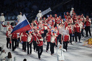 Flag bearer Alexey Morozov of Russian Federation leads his team through the stadium during the Opening Ceremony of the 2010 Vancouver Winter Olympics at BC Place on February 12, 2010 in Vancouver, Canada.