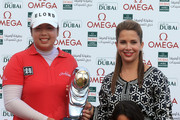 Shanshan Feng of China with HRH Princess Haya Bint Al Hussein, wife of HH Sheikh Mohammed Bin Rashid Al Maktoum, Vice President and Prime Minister of the UAE and Ruler of Dubai and Her daughter, HH Sheikha Al Jalila Bint Mohammed Bin Rashid Al Maktoum during the final round of the 2012 Omega Dubai Ladies Masters on the Majilis Course at the Emirates Golf Club on December 8, 2012 in Dubai, United Arab Emirates.
