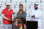 Shanshan Feng of China with HRH Princess Haya Bint Al Hussein, wife of HH Sheikh Mohammed Bin Rashid Al Maktoum, Vice President and Prime Minister of the UAE and Ruler of Dubai and Her daughter, HH Sheikha Al Jalila Bint Mohammed Bin Rashid Al Maktoum and Mohamed Juma Buamaim the deputy Chairman and CEO of Golf in Dubai at teh prize presentation during the final round of the 2012 Omega Dubai Ladies Masters on the Majilis Course at the Emirates Golf Club on December 8, 2012 in Dubai, United Arab Emirates.