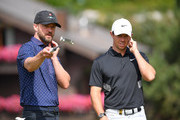 Singer Justin Timberlake of USA and Rory McIlroy of Northern Ireland discuss during the pro-am prior to the start of the Omega European Masters at Crans Montana Golf Club on August 28, 2019 in Crans-Montana, Switzerland.