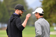 Rory McIlroy and Justin Timberlake talk during the Pro - Am prior to the start of the Omega European Masters at Crans-sur-Sierre Golf Club on August 28, 2019 in Crans-Montana, Switzerland.