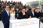 """(L-R) Leonardo DiCaprio, Margot Robbie, Quentin Tarantino, Brad Pitt, David Heyman and Shannon McIntosh attend thephotocall for """"Once Upon A Time In Hollywood""""  during the 72nd annual Cannes Film Festival on May 22, 2019 in Cannes, France."""
