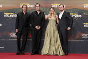 "(L-R) Brad Pitt, Quentin Tarantino, Margot Robbie and Leonardo Di Caprio attend the premiere of ""Once Upon A Time... In Hollywood"" at CineStar on August 01, 2019 in Berlin, Germany."